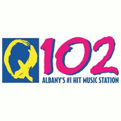 WNUQ 102.1 FM